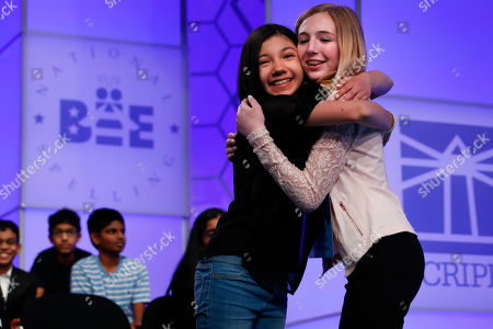 Phoebe Smith, Melodie Loya. Melodie Loya, 13, from Bainbridge, N.Y., left, hugs her friend Phoebe Smith, 12, from Aston, Pa., after Smith was eliminated during the evening finals of the Scripps National Spelling Bee in Oxon Hill, Md., . The girls said they are best friends during a taped segment at the bee