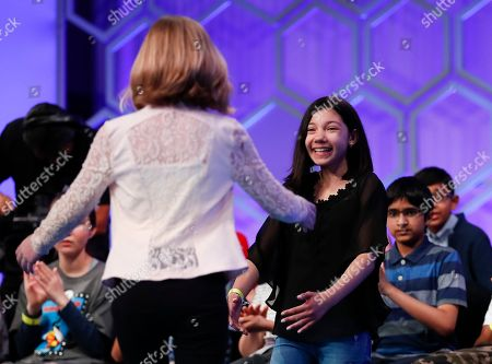 Melodie Loya, Phoebe Smith. Melodie Loya, 13, from Bainbridge, N.Y., right, who did not advance to the evening finals, greets Phoebe Smith, 12, from Aston, Pa., after she spelled a word incorrectly during the Scripps National Spelling Bee in Oxon Hill, Md
