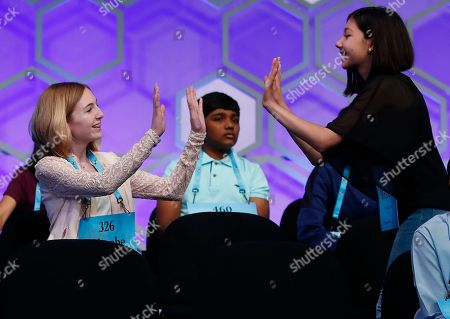 Phoebe Smith, Melodie Loya. Phoebe Smith, 12, from Aston, Pa., left, and Melodie Loya, 13, from Bainbridge, N.Y., celebrate after Phoebe spelled a word correctly during the final round of the Scripps National Spelling Bee in Oxon Hill, Md
