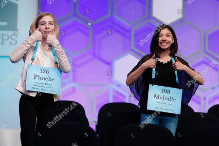 Phoebe Smith, Melodie Loya. Phoebe Smith, 12, from Aston, Pa., and Melodie Loya, 13, from Bainbridge, N.Y., reacts to the audience during a commercial break during the final round of the Scripps National Spelling Bee in Oxon Hill, Md