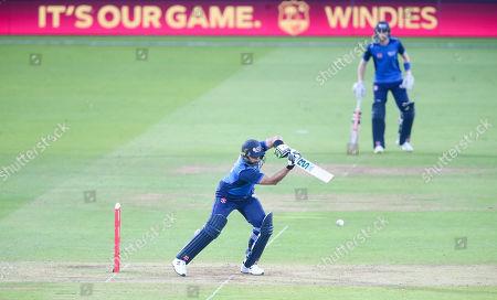 Shahid Afridi (Captain) bats with a runner (R)