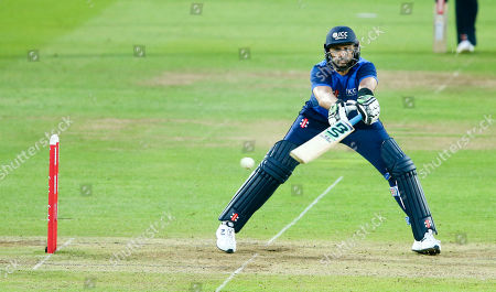 Shahid Afridi (Captain) of World XI bats but with an injury that needed a runner as he awkwardly stretches for a ball