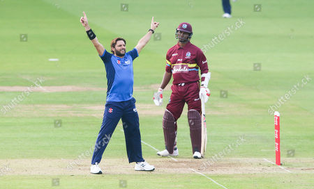 Shahid Afridi (Captain) celebrates the wicket of Andre Fletcher of the West Indies out for 7 runs  stumped Luke Ronchi of the ICC World XI - Marlon Samuels of the West Indies does not look pleased (R)