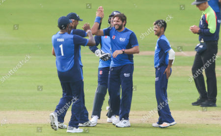 Shahid Afridi (Captain) celebrates the wicket of Andre Fletcher of the West Indies out for 7 runs  stumped Luke Ronchi of the ICC World XI