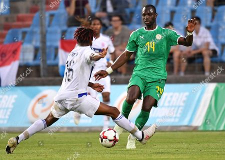 Senegal's Moussa Konate, right, is challenged by Luxembourg's Leandro Barreiro during a friendly soccer match between Luxembourg and Senegal at the Josy Barthel stadium in Luxembourg