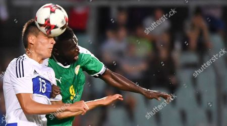Senegal's Mame Biram Diouf, right, goes up against Luxembourg's Dirk Carlson during a friendly soccer match between Luxembourg and Senegal at the Josy Barthel stadium in Luxembourg