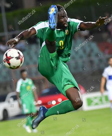 Senegal's Mame Biram Diouf kicks the ball during a friendly soccer match between Luxembourg and Senegal at the Josy Barthel stadium in Luxembourg