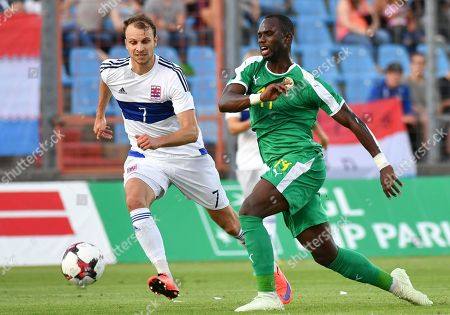 Luxembourg's Lars Gerson, left, chases Senegal's Moussa Konate during a friendly soccer match between Luxembourg and Senegal at the Josy Barthel stadium in Luxembourg