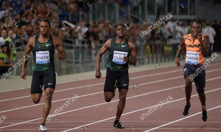 Ronnie Baker, of the United States, left, competes on his way to win the men's 100m event at the Golden Gala, the first European meeting of the Diamond League, at the Rome Olympic Stadium