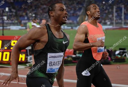 Ronnie Baker, of the United States, left, wins the men's 100m event at the Golden Gala, the first European meeting of the Diamond League, at the Rome Olympic Stadium