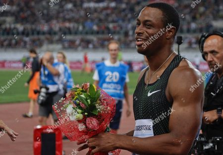 Ronnie Baker, of the United States, reacts after winning the men's 100m event at the Golden Gala, the first European meeting of the Diamond League, at the Rome Olympic Stadium