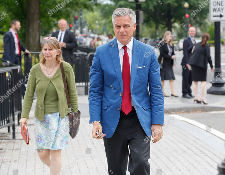 Jon Huntsman, U.S. ambassador to Russia, center, is seen arriving at the security check point entrance of the White House in Washington