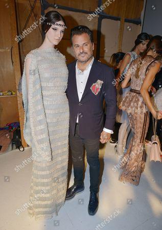 Oscar Carvallo with model