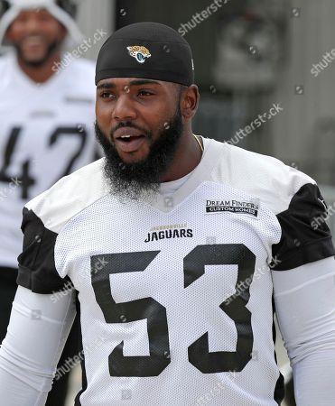 Jacksonville Jaguars linebacker Blair Brown arrives at an NFL football practice, in Jacksonville, Fla