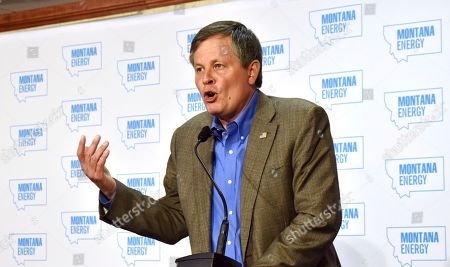U.S. Sen. Steve Daines, R-Mont., makes introductory remarks at an energy conference, in Billings, Mont. Daines says Washington state Gov. Jay Inslee is blocking the export of coal from the Western U.S. to Asia