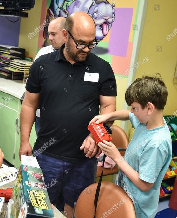 Ian Gomez with patient at Children's Mercy Hospital
