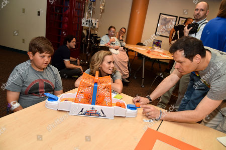 Hilarie Burton and Michael Ian Black with patient at Children's Mercy Hospital