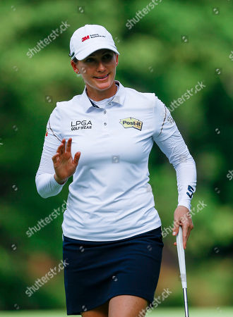 Sarah Smith, of Australia, waves to fans after making a birdie putt on the 17th hole during the first round of the U.S. Women's Open golf tournament, in Birmingham, Ala