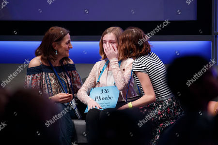 Phoebe Smith, from Morton, Pennsylvania, is comforted after misspelling cabalassou during the final round of the 2018 Scripps National Spelling Bee in National Harbor, Maryland, USA, 31 May 2018. The 16 finalists are competing for 40,000 US dollars and the championship trophy.