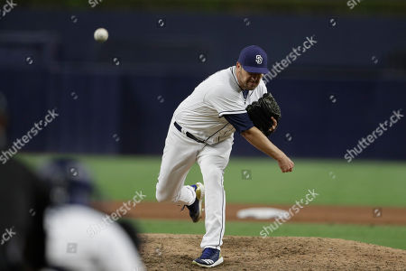 San Diego Padres relief pitcher Phil Hughes works against a Miami Marlins batter during the ninth inning of a baseball game, in San Diego
