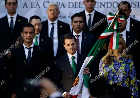 Rafael Marquez, Enrique Pena Nieto, Angelica Rivera. Mexican President Enrique Pena Nieto stands between Mexican national soccer team captain Rafael Marquez, left, and first lady Angelica Rivera, as he prepares to present the national flag to the team ahead of the start of the 2018 World Cup in Russia, at Los Pinos presidential residence in Mexico City