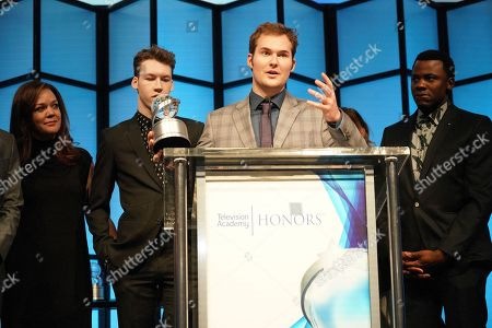 "Stock Picture of Justin Prentice, center, surrounded by cast and crew, accepts on behalf of creator Brian Yorkey, the Television Academy Honor for ""13 Reasons Why,"" and is recognized for using the power of TV to increase awareness and positively impact society at the 11th Annual ""Television Academy Honors"" held at NeueHouse in Los Angeles"