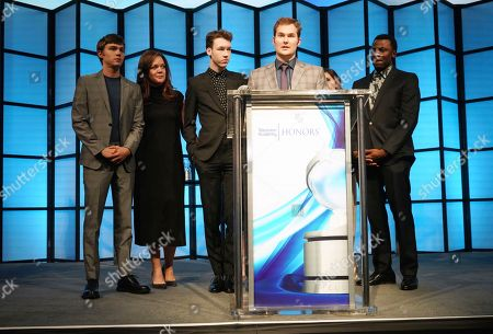 "Justin Prentice, center, surrounded by cast and crew, accepts on behalf of creator Brian Yorkey, the Television Academy Honor for ""13 Reasons Why,"" and is recognized for using the power of TV to increase awareness and positively impact society at the 11th Annual ""Television Academy Honors"" held at NeueHouse in Los Angeles"