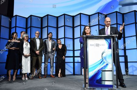 """Mike Royce, Gloria Calderon Kellett, Isabella Gomez, Brent Miller, Rita Moreno, Stephen Tobolowsky, Todd Grinnell, Justina Machado. Mike Royce, from right, and Gloria Calderon Kellett accept the Television Academy Honor for """"One Day at a Time,"""" and are recognized for using the power of TV to increase awareness and positively impact society at the 11th Annual """"Television Academy Honors"""" held at NeueHouse in Los Angeles. Looking on from left are Isabella Gomez, Brent Miller, Rita Moreno, Stephen Tobolowsky, Todd Grinnell and Justina Machado"""