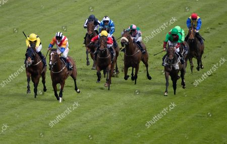 Medburn Dream Trained by P Hedger Ridden by F Norton approaches the line in the lead from Mythical Madness Trained by D O'Meara Ridden by James Doyle in the 14:35 Investec Click & Invest Mile Handicap