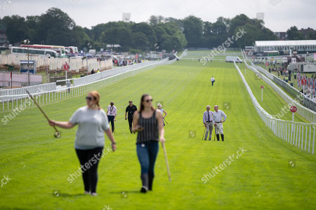 Andrew Cooper, the Clerk of the Course (far right of frame not wearing tie) and others on an inspection walk along the home straight.