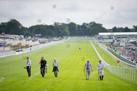 Stock Picture of Andrew Cooper, the Clerk of the Course (far right of frame not wearing tie) and others on an inspection walk along the home straight.