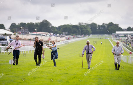 Stock Photo of Andrew Cooper, the Clerk of the Course (far right of frame not wearing tie) and others on an inspection walk along the home straight.
