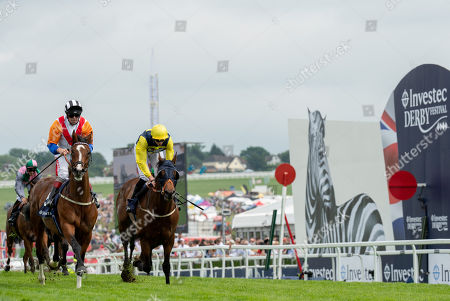 Medburn Dream Trained by P Hedger Ridden by F Norton crosses the finishing line ahead of Mythical Madness Trained by D O'Meara Ridden by James Doyle in the 14:35 Investec Click & Invest Mile Handicap