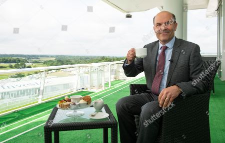Neil Phillips enjoys breakfast on the balcony of the Grand Stand ahead of the day's racing