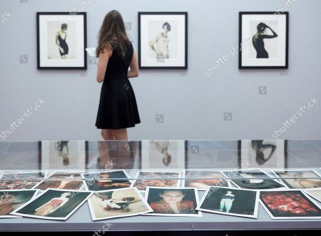 A visitor looks at photographs by Paolo Roversi during a press preview of 'Between Art & Fashion. Photographs from the Collection of Carla Sozzani' at the Helmut Newton Foundation in Berlin, Germany, 01 June 2018. The exhibition runs from 02 June to 18 November.