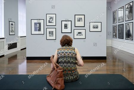 A visitor looks at photographs during a press preview of 'Between Art & Fashion. Photographs from the Collection of Carla Sozzani' at the Helmut Newton Foundation in Berlin, Germany, 01 June 2018. The exhibition runs from 02 June to 18 November.