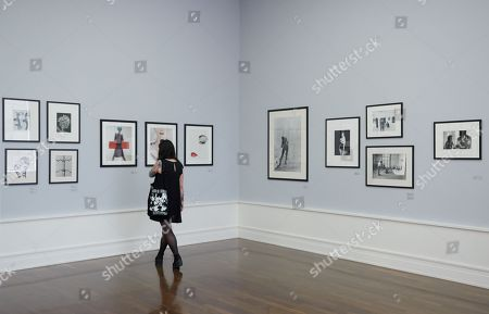 A visitor looks at photographs by Edwin Blumenfeld during a press preview of 'Between Art & Fashion. Photographs from the Collection of Carla Sozzani' at the Helmut Newton Foundation in Berlin, Germany, 01 June 2018. The exhibition runs from 02 June to 18 November.