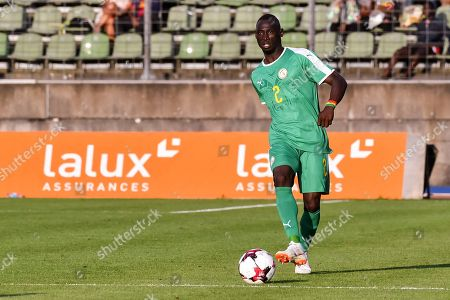 Stock Image of Senegal's Saliou Ciss kicks the ball during a friendly soccer match between Luxembourg and Senegal at the Josy Barthel stadium in Luxembourg