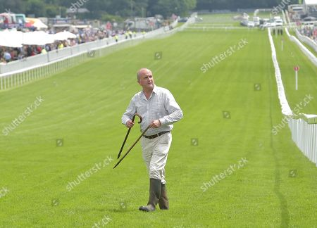 Andrew Cooper, Clerk of The Course, inspects the going and keeps an eye on the weather.