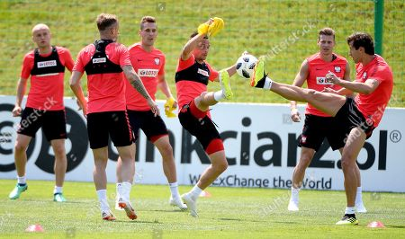 Polish national soccer team players (L-R) Michal Pazdan, Kamil Grosicki, Arkadiusz Milik, Slawomir Peszko, Lukasz Piszczek, and Grzegorz Krychowiak perform during their team's training session in Arlamow, Poland, 01 June 2018. The Polish team prepares for the FIFA World Cup 2018 taking place in Russia from 14 June until 15 July 2018.