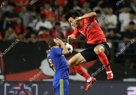 Stock Photo of Oh Ban-suk, Edin Visca. South Korea's Oh Ban-suk, right, fights for the ball against Bosnia and Herzegovina's Edin Visca during a friendly soccer match at Jeonju World Cup Stadium in Jeonju, South Korea
