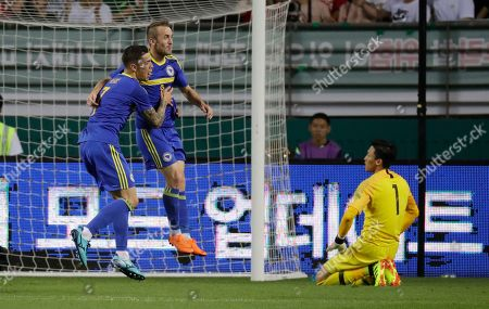 Edin Visca, Muhamed Besic, Kim Seung-gyu. Bosnia and Herzegovina's Edin Visca, center, celebrates after scoring his side's third goal with teammate Muhamed Besic, left, over South Korea's goal keeper Kim Seung-gyu during a friendly soccer match at Jeonju World Cup Stadium in Jeonju, South Korea