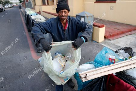 A homeless South African man collects plastic bottles to sell to a recycling depot gathered from residential waste bins in Muizenberg, Cape Town, South Africa, 30 May 2018. Plastic pollution has reached epidemic proportion. According to an Ellen MacArthur Foundation report there will be more plastic in the ocean than fish by 2050. Africa is one of the most affected continents due to its extensive coastline and underdeveloped waste systems allowing plastic waste to easily enter the ocean.  The rapid growth of plastic production in the three biggest areas the European Union, China and the US particularly in single-use plastics is recognised as one of the greatest risks facing the environment and mankind. Efforts at recycling and plastic waste education are on the rise on the African continent with many programs being initiated by youth groups who view the problem as the biggest environmental challenge facing the new generation.