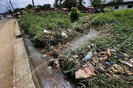 Illegally dumped plastic waste congests a stream in Monrovia, Liberia 30 May 2018. Plastic pollution has reached epidemic proportion. According to an Ellen MacArthur Foundation report there will be more plastic in the ocean than fish by 2050. Africa is one of the most affected continents due to its extensive coastline and underdeveloped waste systems allowing plastic waste to easily enter the ocean.  The rapid growth of plastic production in the three biggest areas the European Union, China and the US particularly in single-use plastics is recognised as one of the greatest risks facing the environment and mankind. Efforts at recycling and plastic waste education are on the rise on the African continent with many programs being initiated by youth groups who view the problem as the biggest environmental challenge facing the new generation.