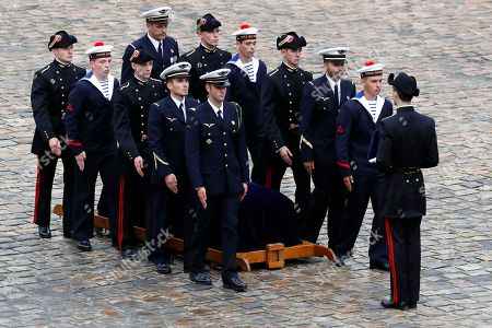 Pallbearers stand around Serge Dassault's coffin during his funeral ceremony at Saint-Louis-des-Invalides Cathedral in Paris, France, 01 June 2018. French business executive and politician Serge Dassault died on 28 May at the age of 93.