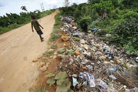 A Liberian boy walks past plastic waste illegally dumped on a roadside in Monrovia, Liberia 30 May 2018. Plastic pollution has reached epidemic proportion. According to an Ellen MacArthur Foundation report there will be more plastic in the ocean than fish by 2050. Africa is one of the most affected continents due to its extensive coastline and underdeveloped waste systems allowing plastic waste to easily enter the ocean.  The rapid growth of plastic production in the three biggest areas the European Union, China and the US particularly in single-use plastics is recognised as one of the greatest risks facing the environment and mankind. Efforts at recycling and plastic waste education are on the rise on the African continent with many programs being initiated by youth groups who view the problem as the biggest environmental challenge facing the new generation.