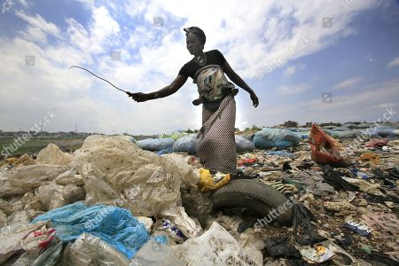An Ivorian woman collects plastic bottles to sell for recycling from the general waste at the Akouedo recycling depot and landfill site in Abidjan, Ivory Coast, 29 May 2018. Plastic pollution has reached epidemic proportion. According to an Ellen MacArthur Foundation report there will be more plastic in the ocean than fish by 2050. Africa is one of the most affected continents due to its extensive coastline and underdeveloped waste systems allowing plastic waste to easily enter the ocean.  The rapid growth of plastic production in the three biggest areas the European Union, China and the US particularly in single-use plastics is recognised as one of the greatest risks facing the environment and mankind. Efforts at recycling and plastic waste education are on the rise on the African continent with many programs being initiated by youth groups who view the problem as the biggest environmental challenge facing the new generation.