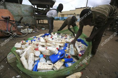 Ivorian men gather plastic bottles to sell at the Akouedo recycling depot and landfill site in Abidjan, Ivory Coast, 29 May 2018. Plastic pollution has reached epidemic proportion. According to an Ellen MacArthur Foundation report there will be more plastic in the ocean than fish by 2050. Africa is one of the most affected continents due to its extensive coastline and underdeveloped waste systems allowing plastic waste to easily enter the ocean.  The rapid growth of plastic production in the three biggest areas the European Union, China and the US particularly in single-use plastics is recognised as one of the greatest risks facing the environment and mankind. Efforts at recycling and plastic waste education are on the rise on the African continent with many programs being initiated by youth groups who view the problem as the biggest environmental challenge facing the new generation.