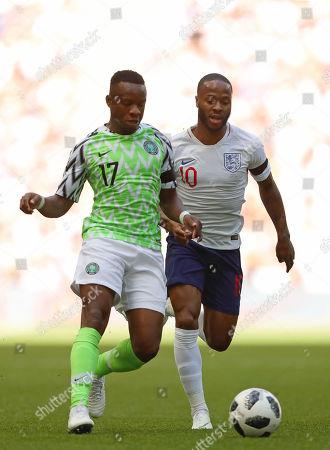 Stock Image of Raheem Sterling of England and Ogenyi Onazi of Nigeria - England v Nigeria, International Friendly, Wembley Stadium, London - 2nd June 2018.
