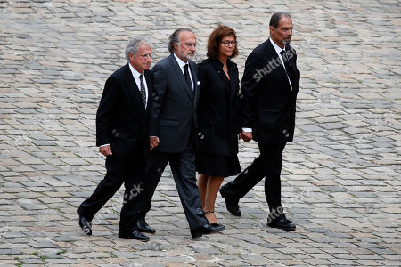 Stock Image of The Children of late Serge Dassault, Chairman and CEO of Dassault Group, from left to right, Laurent Dassault, Olivier Dassault, Marie-Helene Habert-Dassault and Thierry Dassault, walk behind their father's coffin during the funeral ceremony at Hotel des Invalides in Paris, France, . French business executive Serge Dassault, a top aviation and arms industrialist, has died in his Paris office. He was 93